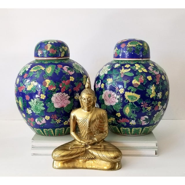 Lovely set of contemporary ginger jars, presented as a deep bright royal blue with floral blooms of soft yellow, petal...