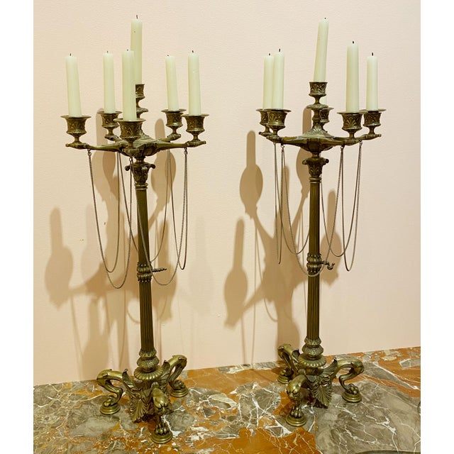 A pair of French empire bronze candelabrum from the early 19th century, about 1815. All chains are intact and these are in...