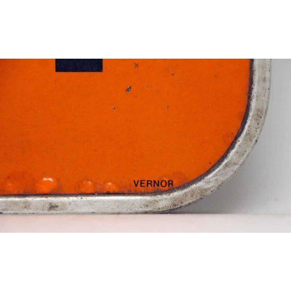 Orange and black telephone sign. Stamped Vernor. The back is stamped Martin International. Priced each.