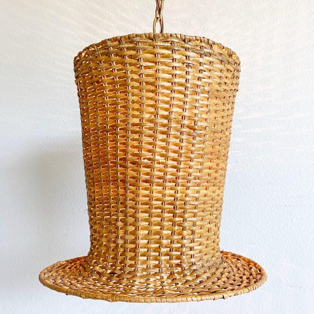 Whimsical 1970s natural wicker pendant light in the shape of a top hat with ribbed metal frame. Newly wired with new...
