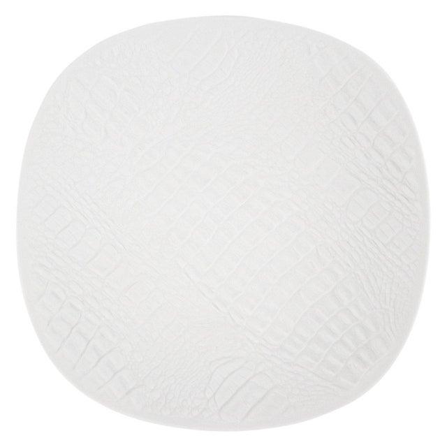 White Modernist bisque porcelain plate featuring a unique crocodile bas relief texture. In excellent condition.