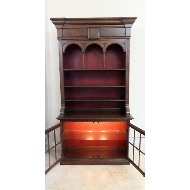 Hekman Furniture 2-piece display cabinet. Base features 2 fretwork doors with glass inserts and lighted interior with one...