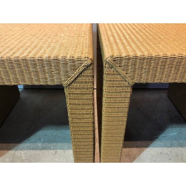 Pair of Janus et Cie rolled kraft paper saturated in resin wicker tables from a designer decorated home in Palm Beach.