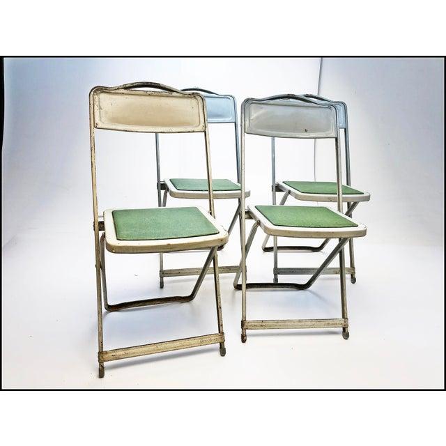 (4) Vintage Metal Folding Chair Set. Beautiful American craftsmanship. Solid metal with green vinyl seat. Metal frames...