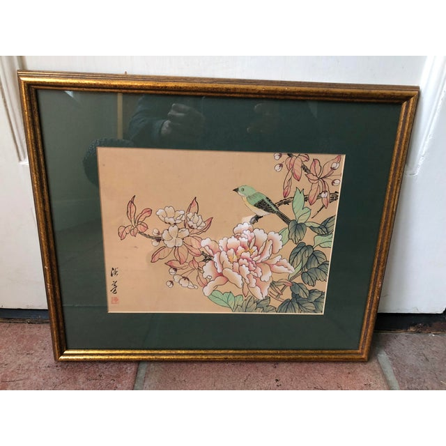 A beautifully rendered pair of Chinese watercolor and ink paintings on silk. Images of birds and butterflies on peonies....