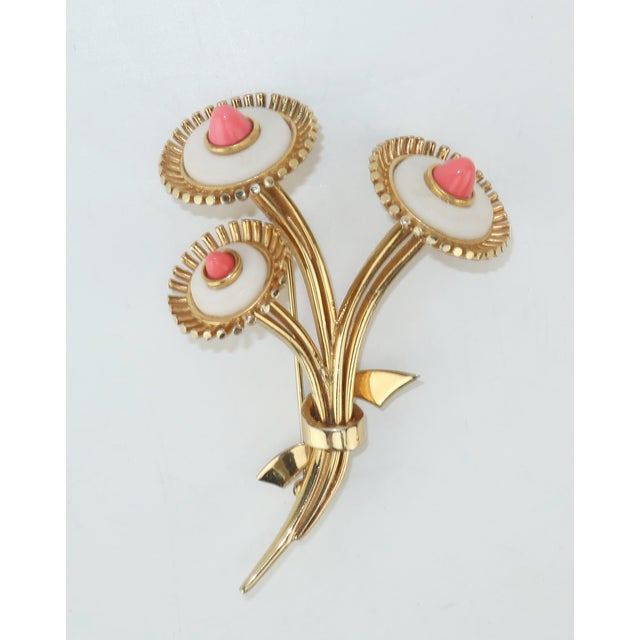 Get a touch of vintage and all the majestic influence of Spring with this 1950's Marcel Boucher gold tone floral brooch....