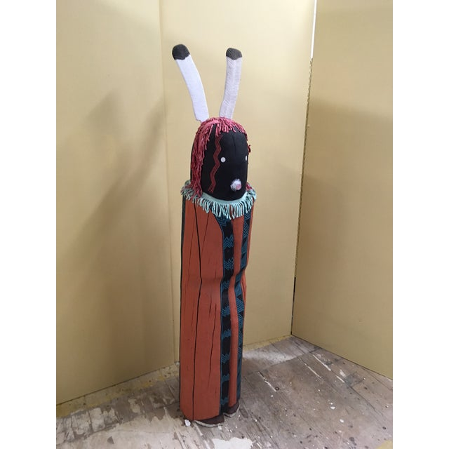 Effigy kachina of Monster Slayer by Navajo folk artist Dennis Pioche. Carved and painted wood with leather. 64 inches tall...