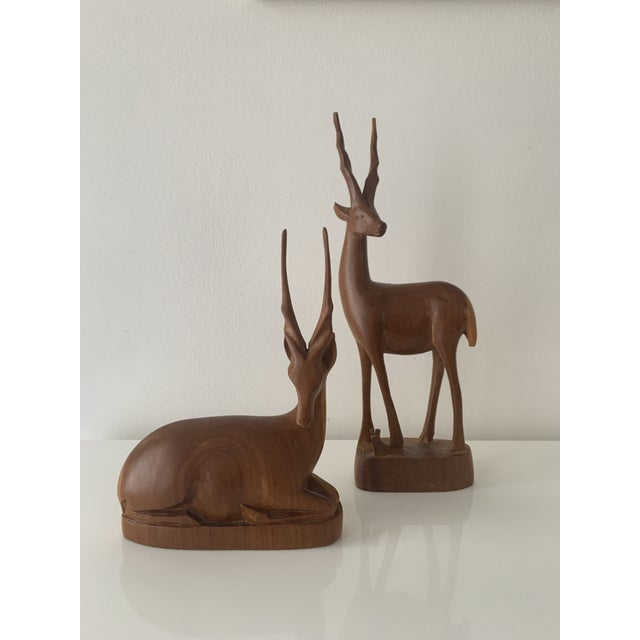 Mid Century Teak Antelope Figures. A finely carved pair of solid teak wood antelopes in excellent vintage condition....