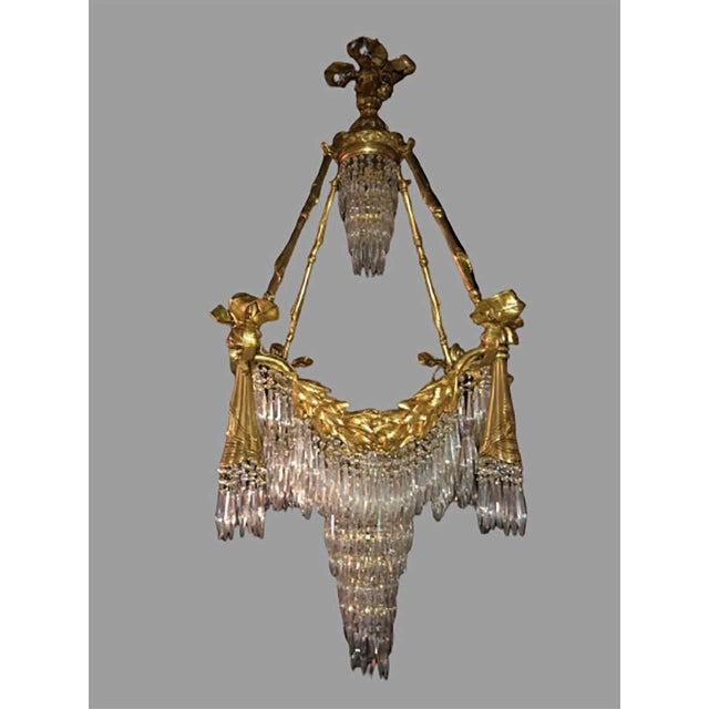 Bronze Louis XVI style crystal ribbon and tassel drapery chandelier with 18 lights. Newly wired. This fine custom quality...