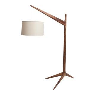 Solid guanacaste floor lamp by Gabriela Valenzuela-Hirsch shown with linen shade