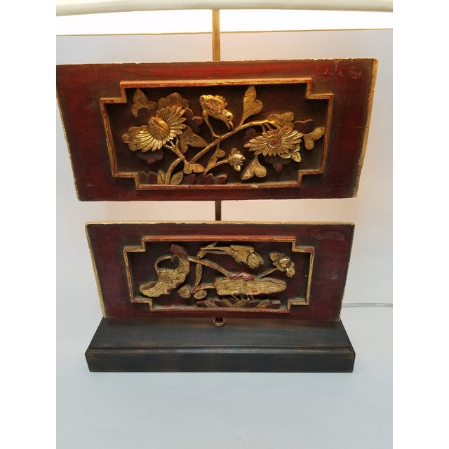 Lamp custom created with antique Chinese carved wood panels. The panels are a relief carved floral design highlighted with...