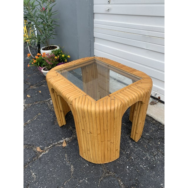 """Mid-century handcrafted bamboo coffee table. This boho chic """"waterfall"""" cocktail table is designed of split bamboo reeds..."""