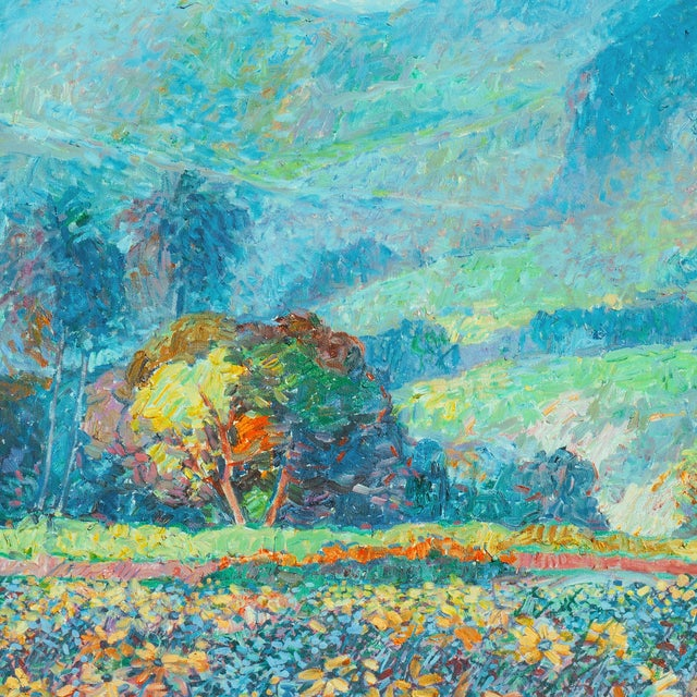 A exceptionally fine impressionist oil landscape showing a view of a field of wildflowers with a cottage sheltered in a...