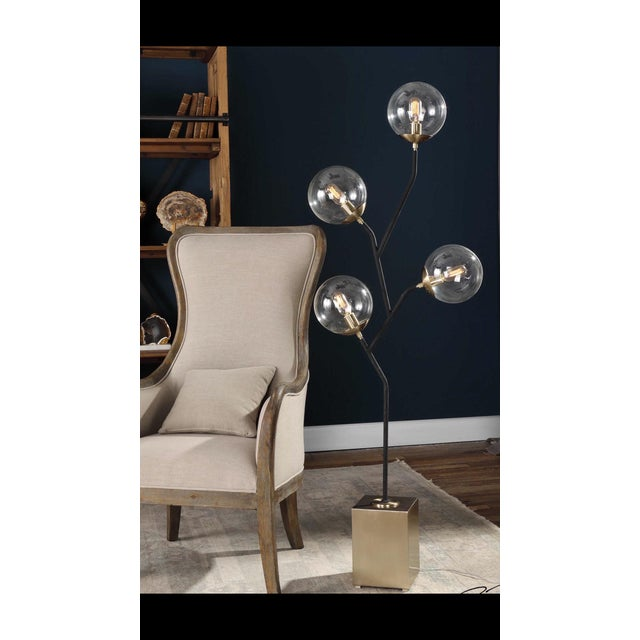 Listing is for one lamp; and there is a pair available of these very groovy light fixtures. I love the black brass and...