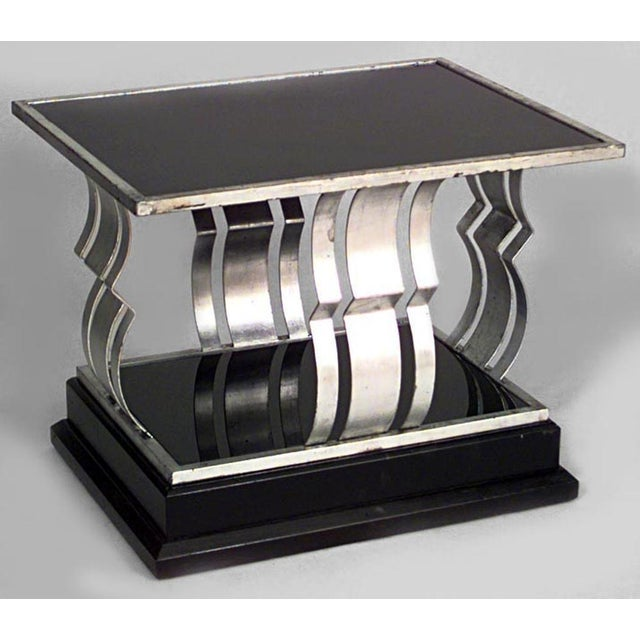 Pair of French Art Deco rectangular silver and black painted iron end tables with open geometric design sides and black...