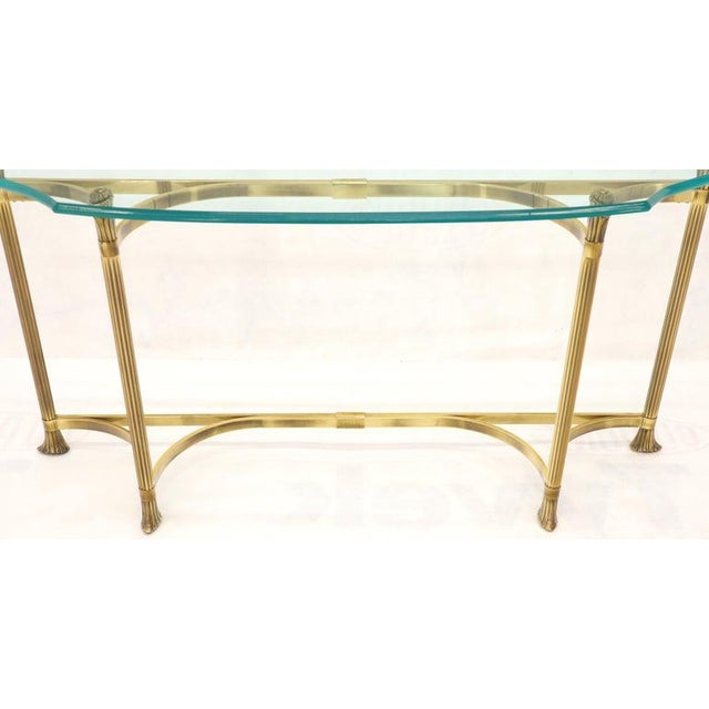 Mid-Century Modern brass and glass concave demilune shape top console table. In style of Mastercraft. NYC area delivery...