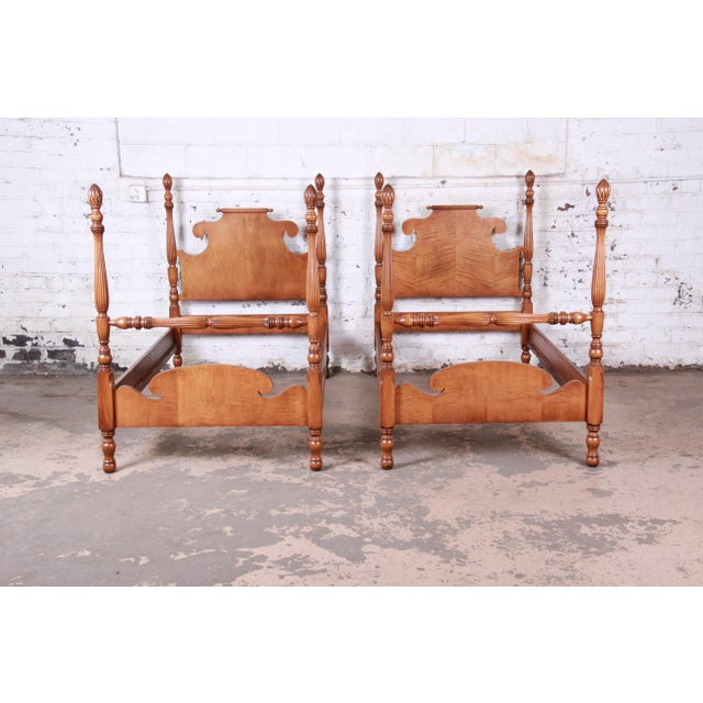 """A gorgeous pair of carved tiger maple twin size pineapple poster beds USA, Circa 1950s Measures: 41.5""""W x 79.75""""D x..."""