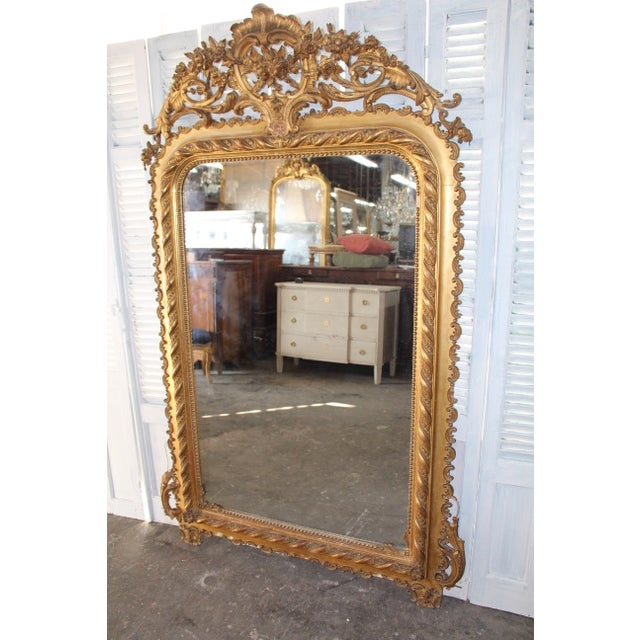18th Century Grand Louis Philippe period mirror with original giltwood frame and original mercury glass. Directly imported...