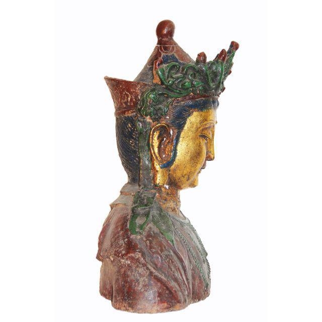 A metal Kwan Yin, Goddess of Mercy and Compassion, bust presented in metal with a multitude of once vibrant colors,...
