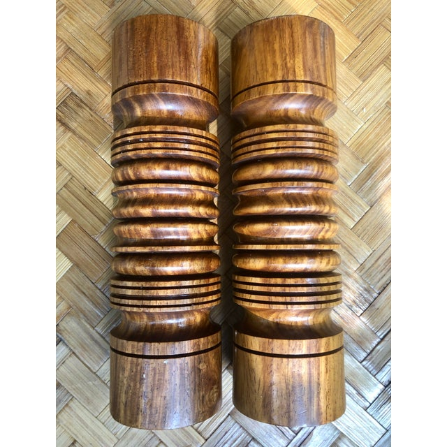 What a handsome pair! These substantial mid-century modern turned wood candlesticks would be outstanding in a collection...