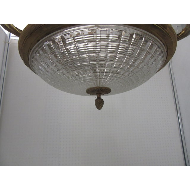 Beautiful 1910's French Bowl Chandelier with elaborate bronze casting detail including rope chains and wreaths. Cut...