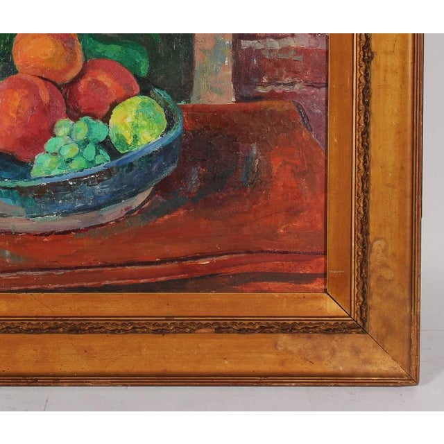 This mid to late 20th century oil on canvas still life with fruit and a monstera plant is by Monterey/Carmel artist of...