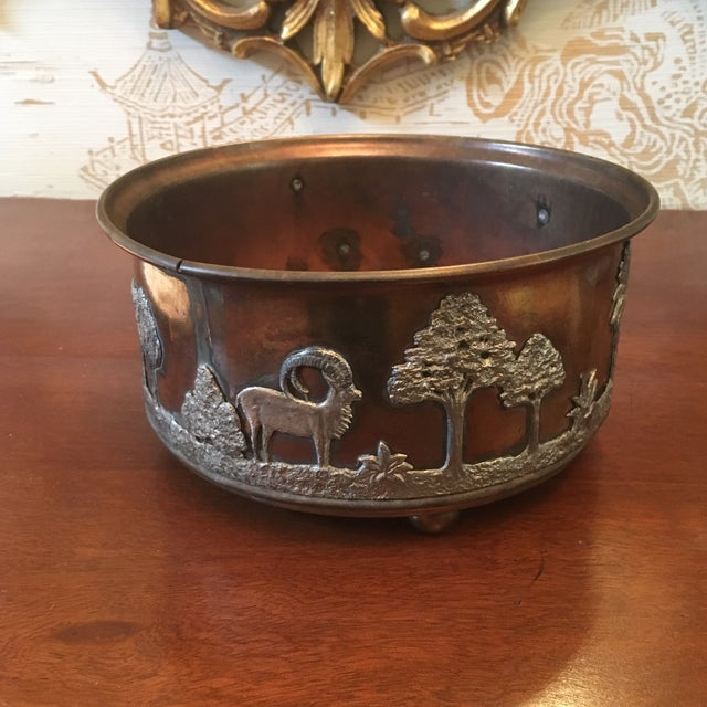 Unusual antique circa 1900 copper and silverplate Jardinere depicting African wildlife. Some pulling away from seam but in...