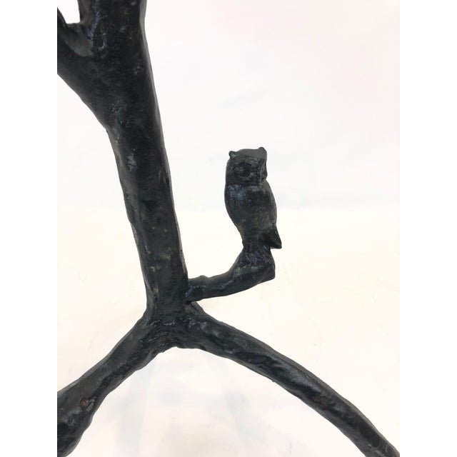 An elegant Giacometti style iron based side table having tree like shape with branches, leaves and a wonderful perched...