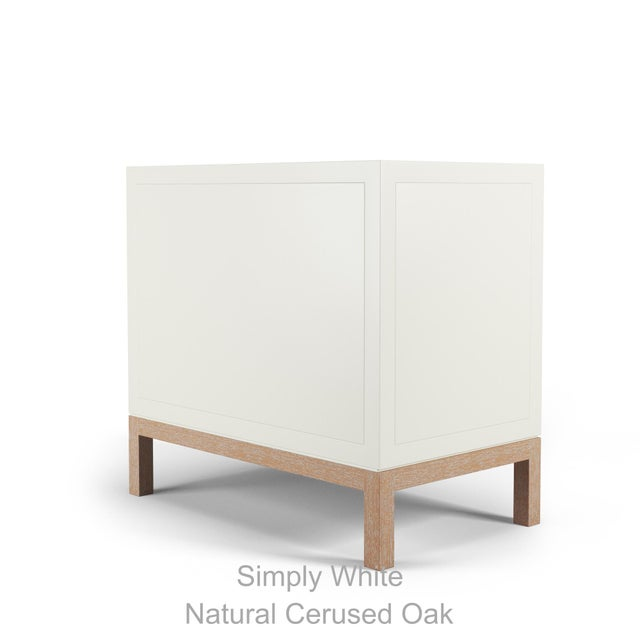 Oversized side table with geometric cuts in her façade, two draws keep all your important items nearby and tucked away.ish.