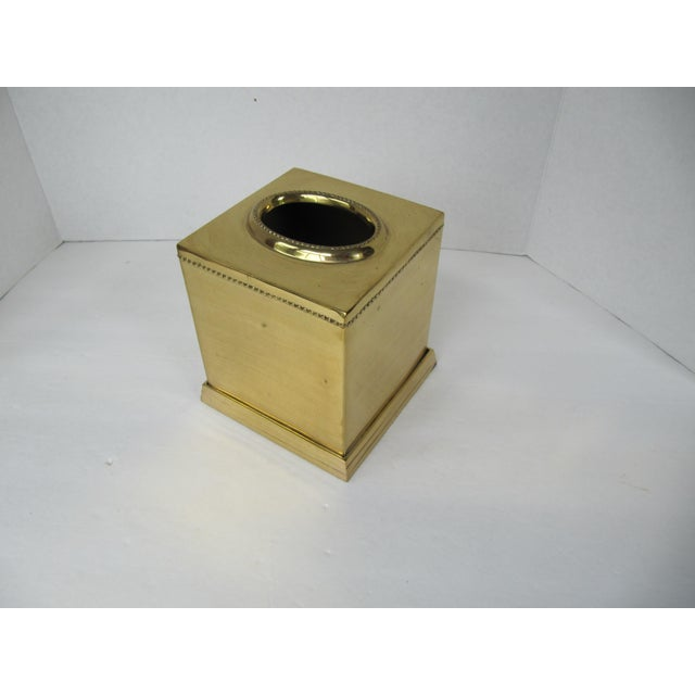 Dress up your tissue box heavy brass tissue box holder with dot details.