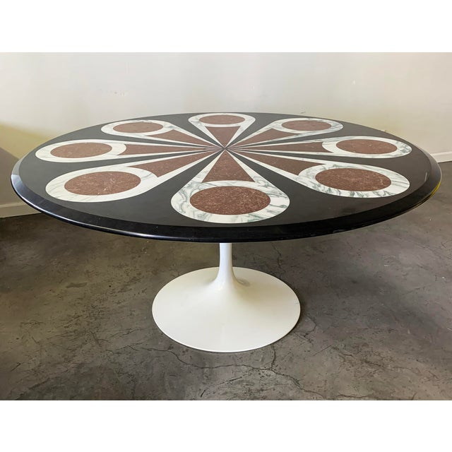 This dining table is absolutely stunning! A Knoll, Eero Saarinen dining table with a custom designed black marble with...