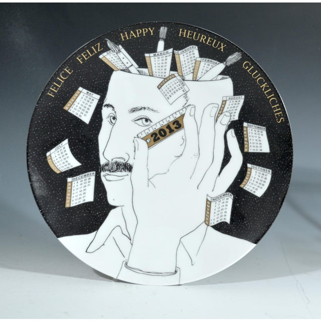 Fornasetti Calendar Plate for 2013, Numbered 92 of 700. by Barnaba Fornasetti. The design of Piero Fornasetti is based on...