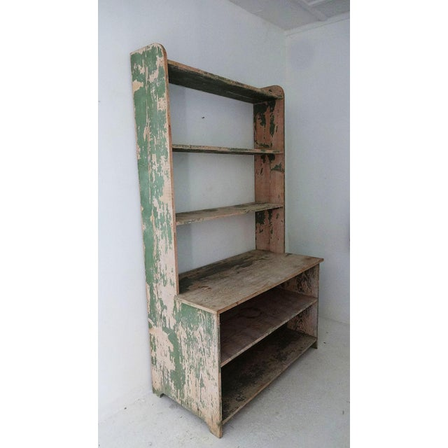 A 19th century, old stepback pine hutch, with remaining traces of green paint. The top shelves measure 11 1/2 inches wide....