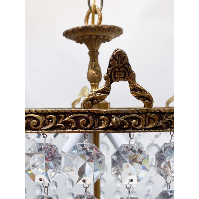 Italian Basket chandelier with decorative brass rim and 30% led graduated octagon chain. it has 3 candelabra base sockets...