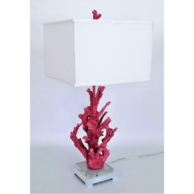 Offering an outstanding large pink coral resin lamp with a square white fabric shade and matching pink coral finial, circa...