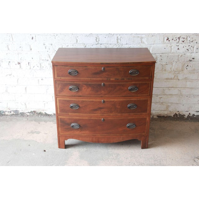 Offering a beautiful mahogany four-drawer chest of drawer by Baker Furniture. The chest display a stunning mahogany wood...