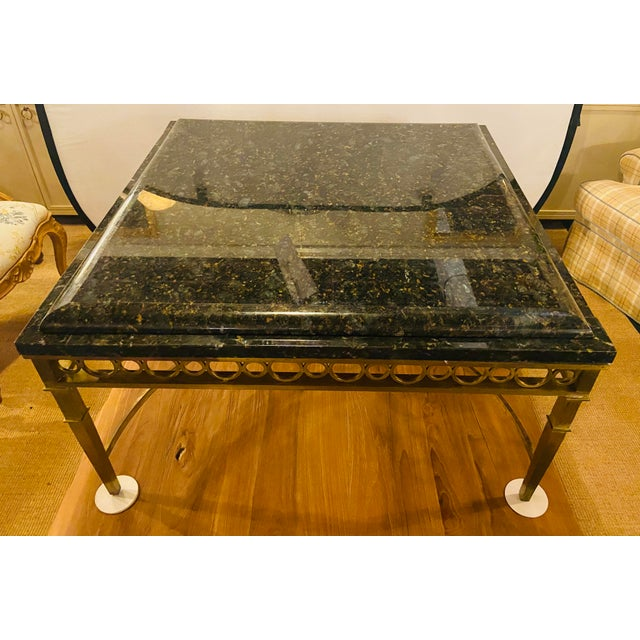Hollywood Regency granite top on brass base center or cocktail table. This lovely square shaped Hollywood Regency center...