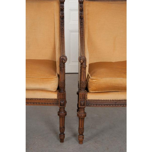 French French 19th Century Louis XVI Carved Walnut Bergères - a Pair For Sale - Image 3 of 12