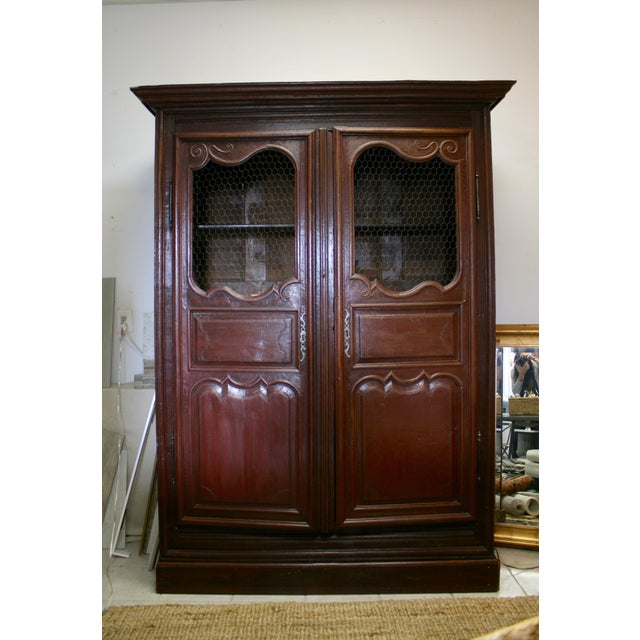Rich hand carved English armoire.
