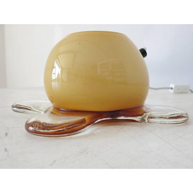 Original vintage table lamp in amber white and clear Murano glass in incamiciato technique / Designed by Murano Due circa...
