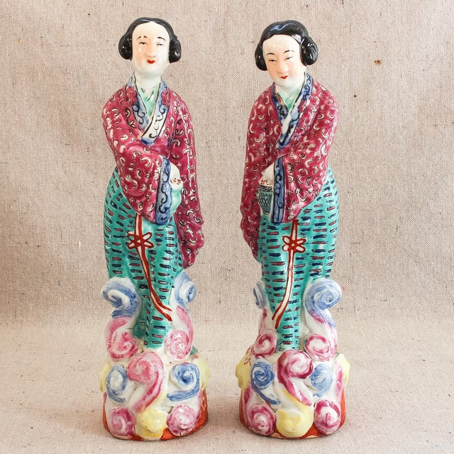 Antique pair of Chinese famille rose statuettes of two immortal women. Figures are mirrored with subtle variations in...