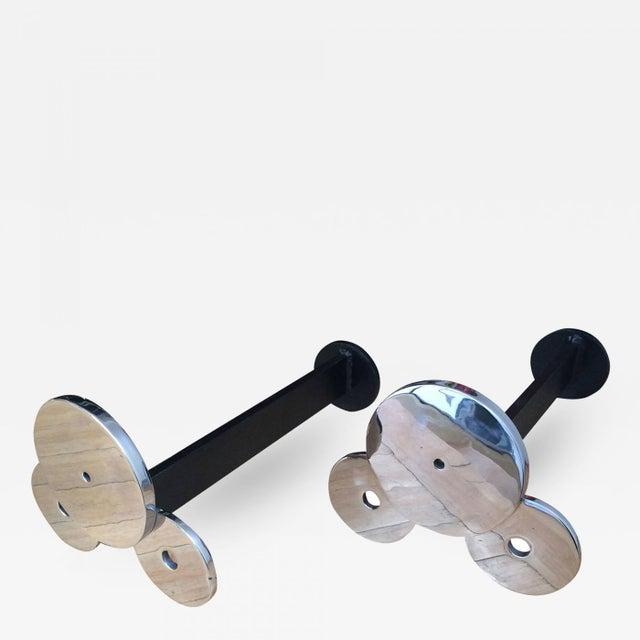 Francois Monnet Superb design pair of Circle andiron.