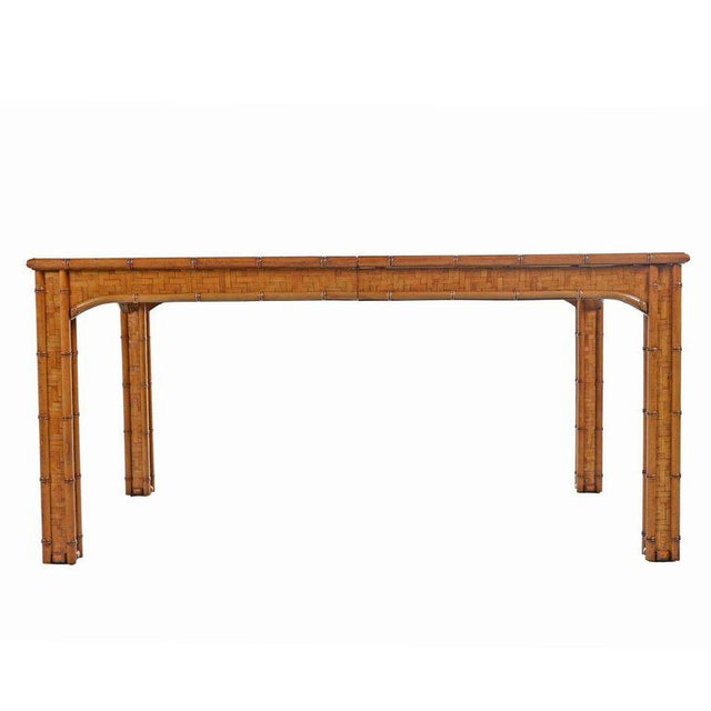 1970's vintage Parsons style dining table or writing desk. Sturdy hardwood construction, completely veneered with a woven...