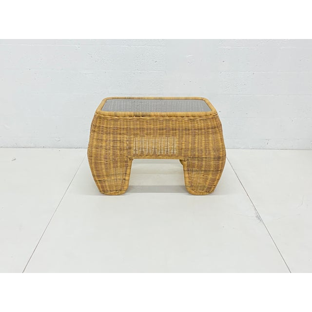 Pair of handmade wicker / rattan sculptural organic modern side tables with smoked glass tops from the 1970s.