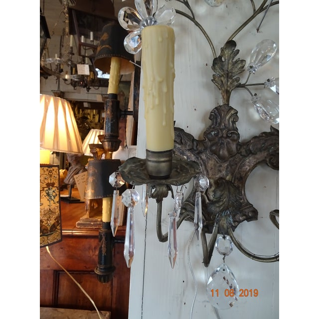 A beautiful pair of tole and crystals Italian sconces with acanthus motif. 6 Crystals hang from each bobeche. The top of...