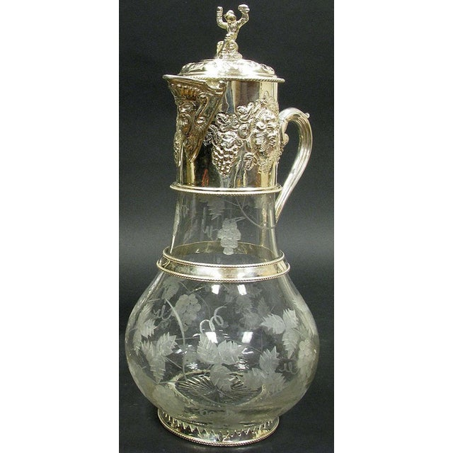 Pair of monumental English sliver plated, engraved and cut glass claret jugs, impressive and functional, The figural lids,...