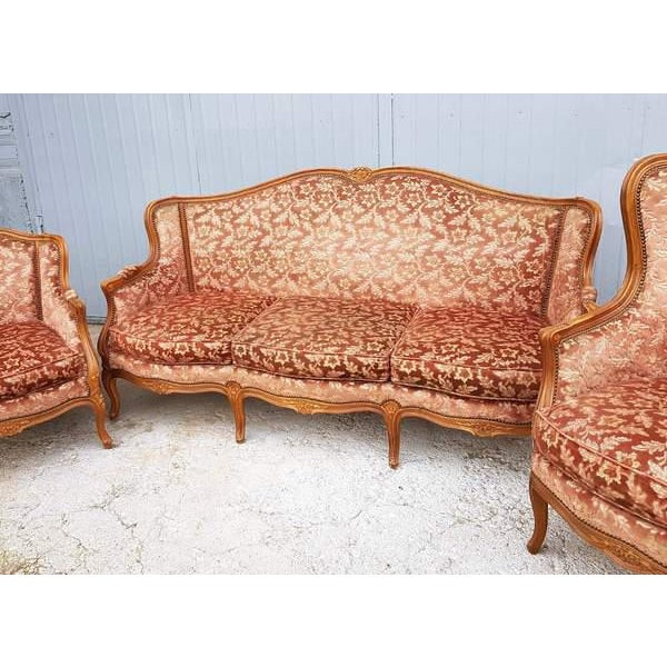 Three Piece French Louis XV Style Carved Parlor Suite, 20th c., consisting of a large wingback settee and two wingback...