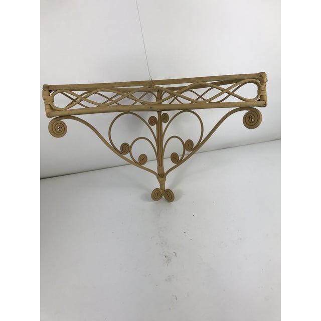 Never seen one of these adorable curly wicker wall shelves. This one is in excellent condition with no missing curls. It...