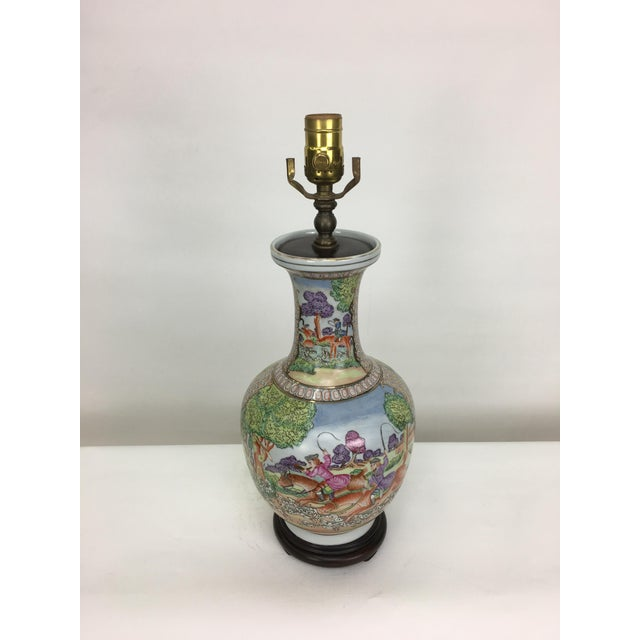 Japanese-style bottleneck vase with a whimsical design. All around the body of this charming lamp is a painted scene of...