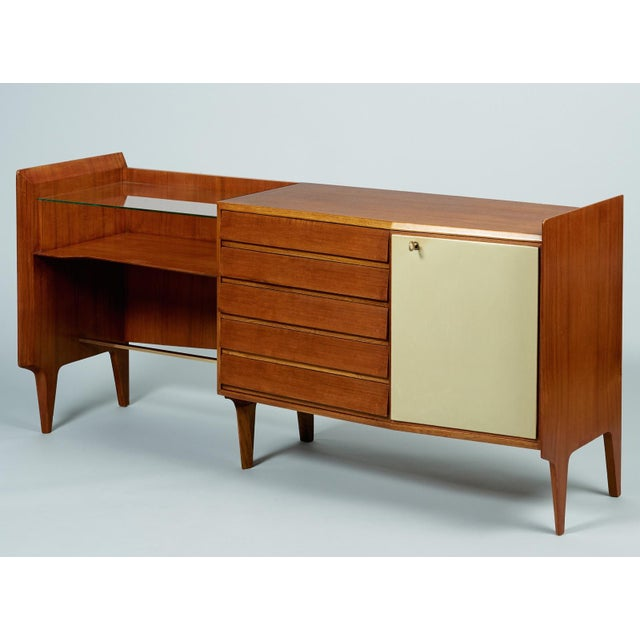 An exceptional and rare asymmetrical credenza by modernist master Gio Ponti, in mahogany with five drawers, angled subtly...